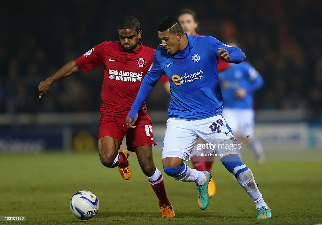 Nathaniel Mendez-Laing of Peterborough battles with Bradley Pritchard of Charlton during the npower Championship match between Peterborough United and Charlton Athletic at London Road Stadium on March 5, 2013 in Peterborough, England.