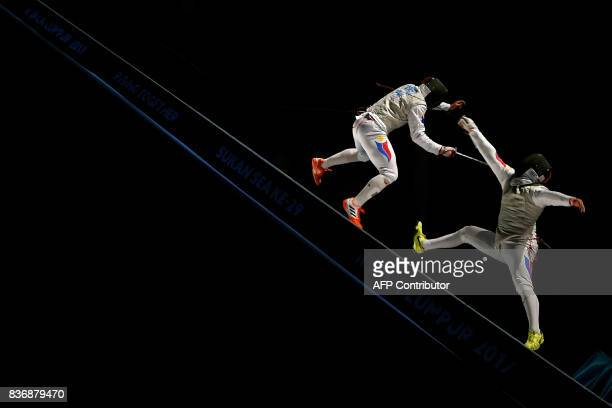 TOPSHOT Nathaniel Perez of Philippines competes with compatriot Brennan Wayne Louie in the men's fencing foil individual final of the 29th Southeast...