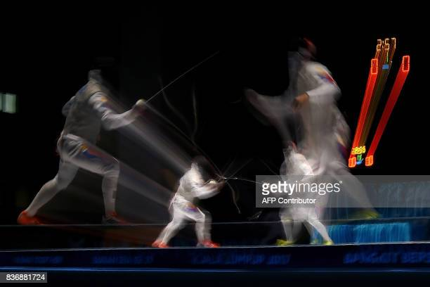Nathaniel Perez of the Philippines competes with compatriot Brennan Wayne Louie in the men's fencing foil individual final of the 29th Southeast...