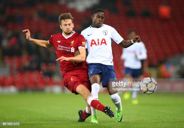 Nathaniel Phillips of Liverpool tackles Shilow Tracey of Tottenham Hotspur during the Premier League 2 match between Liverpool and Tottenham Hotspur...