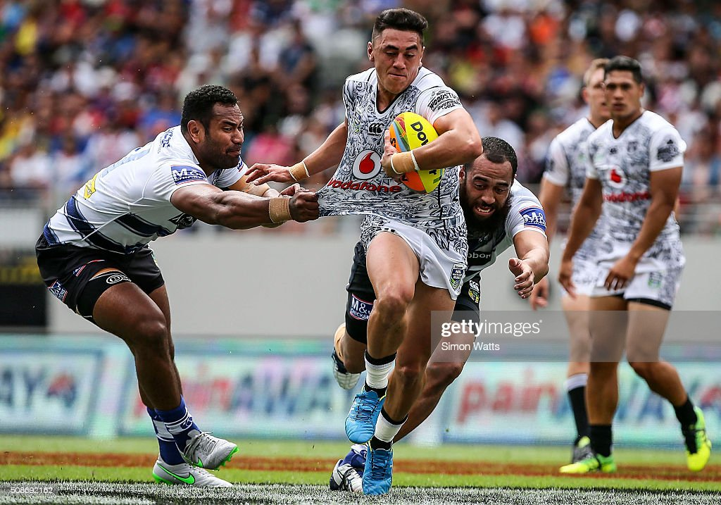 Nathaniel Roache of the Warriors makes a break during the 2016 Auckland Nines match between the Warriors and the Cowboys at Eden Park on February 6, 2016 in Auckland, New Zealand.