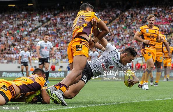 Nathaniel Roache of the Warriors scores a try during the 2016 Auckland Nines match between the Warriors and the Broncos at Eden Park on February 7...
