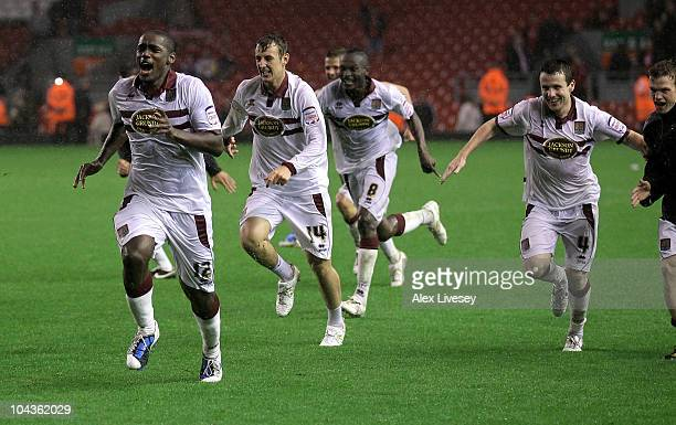 Nathaniel Wedderburn of Northampton Town and his team mates celebrate after winning a penalty shootout during the Carling Cup Third Round game...