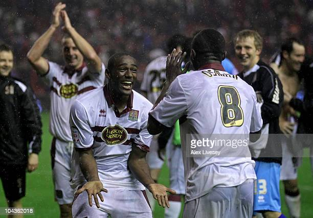 Nathaniel Wedderburn of Northampton Town celebrates with team mate Abdul Osman after winning a penalty shootout during the Carling Cup Third Round...