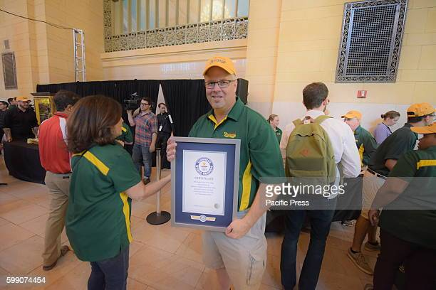 Nathan's Famous VP Scott Harvey holding official Guinness proclamation Led by Nathan's Famous George Shea 2016 Hotdog Eating Champion Joey Chestnut...