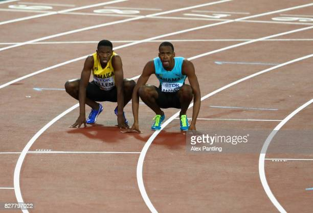 Nathon Allen of Jamaica and Steven Gardiner of Bahamas react after the Men's 400 metres final during day five of the 16th IAAF World Athletics...