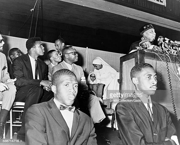 Nation of Islam religious leader Elijah Muhammad addresses followers including Cassius Clay Image credit Stanley Wolfson/Library of Congress 1964