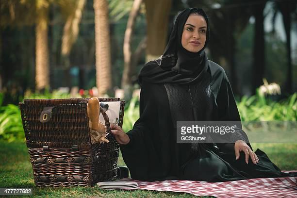 UAE National, a modern arab woman in a park