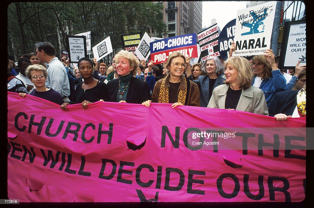 National Abortion and Reproductive Rights Action League leader Kelli Conlin, feminist Gloria Steinem, actress Olympia Dukakis and other protestors hold up a banner at the Women's Rights rally October 7, 1995 in New York City. The rally protested the arrival of Pope John Paul II, whose conservative doctrine on issues such as abortion, sex, and homosexuality contradict the ideology of many women's rights groups.