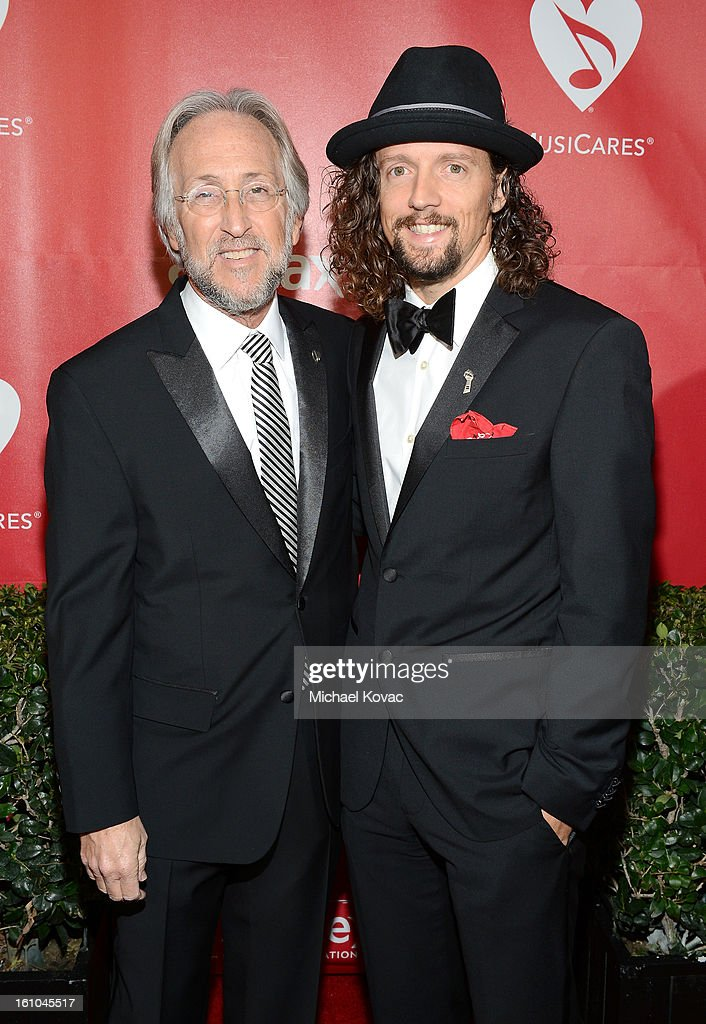 National Academy of Recording Arts and Sciences President Neil Portnow (L) and musician Jason Mraz attend MusiCares Person Of The Year Honoring Bruce Springsteen at the Los Angeles Convention Center on February 8, 2013 in Los Angeles, California.
