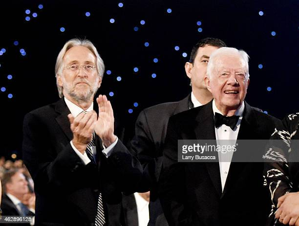 National Academy of Recording Arts and Sciences President Neil Portnow and former US President Jimmy Carter attend the 25th anniversary MusiCares...