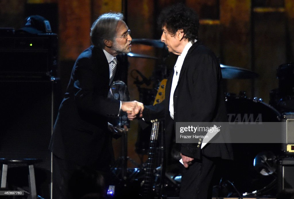 National Academy of Recording Arts and Sciences President Neil Portnow (L) and honoree Bob Dylan appear onstage at the 25th anniversary MusiCares 2015 Person Of The Year Gala honoring Bob Dylan at the Los Angeles Convention Center on February 6, 2015 in Los Angeles, California. The annual benefit raises critical funds for MusiCares' Emergency Financial Assistance and Addiction Recovery programs.