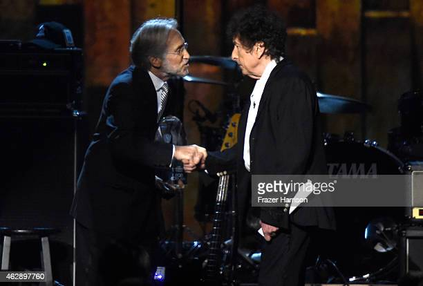 National Academy of Recording Arts and Sciences President Neil Portnow and honoree Bob Dylan appear onstage at the 25th anniversary MusiCares 2015...