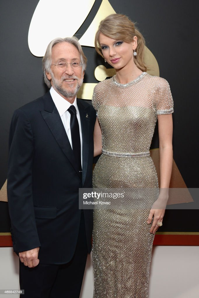 National Academy of Recording Arts and Sciences President Neil Portnow and singer Taylor Swift attend the 56th GRAMMY Awards at Staples Center on January 26, 2014 in Los Angeles, California.