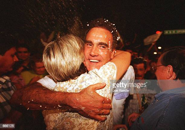 National Action Party politician Gustavo Elizondo the mayor of Ciudad Juarez Mexico receives a hug after news that Vicente Fox of PAN won the Mexican...