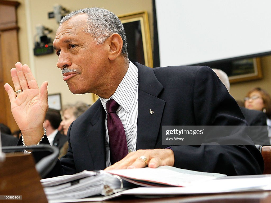 National Aeronautics and Space Administration (NASA) Administrator Charles Bolden waves to committee members as he waits for the beginning of a hearing before the House Science and Technology Committee May 26, 2010 on Capitol Hill in Washington, DC. The hearing was to review proposed human spaceflight plan by NASA.