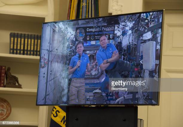 National Aeronautics and Space Administration astronauts Peggy Whitson left and Jack Fischer appear on screen from the International Space Station...