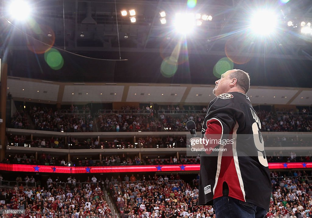 National Anthem Singer Patrick Lauder looks up the stands as the fans sing along before the NHL game between the Phoenix Coyotes and the Colorado Avalanche at Jobing.com Arena on April 26, 2013 in Glendale, Arizona. The Avalanche defeated the Coyotes 5-4 in an overtime shoot-out.