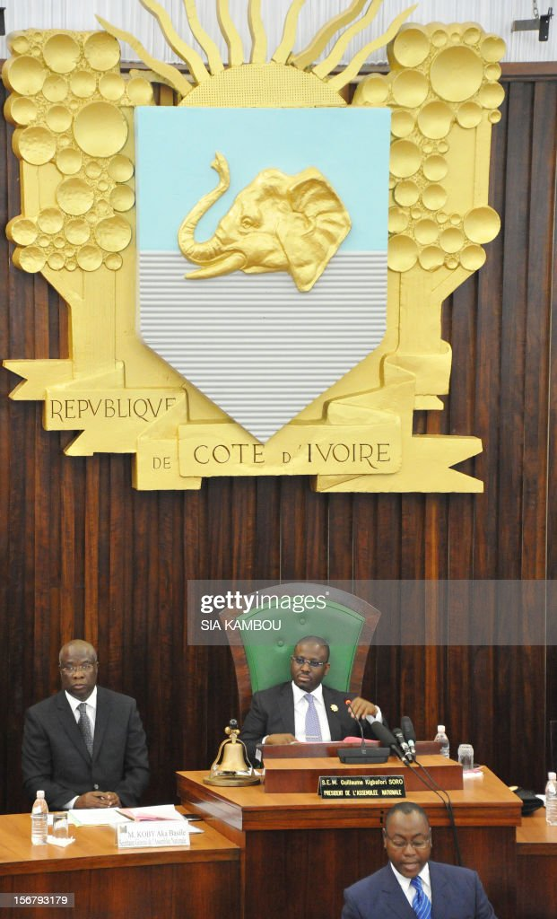 National Assembly President Guillaume Soro (C) on November 21, 2012 supervises the vote on bills presented by the government at the parliament in Abidjan. President Alassane Ouattara on November 14 dissolved the government formed in March and charged with reviving the country after the political and military crisis of 2010-2011 due to differences among the governing parties -- Ouattara's RDR, former president Henri Konan Bedie's PDCI and the small UDPCI party. AFP PHOTO / SIA KAMBOU