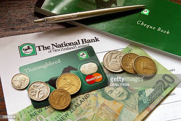 National Bank of New Zealand MasterCard sits amongst New Zealand currency in Auckland 08 October 2003 Britain''s Lloyd''s TSB is selling the National...