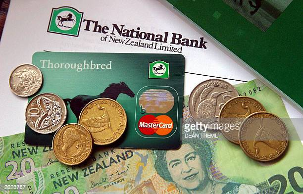 National Bank of New Zealand MasterCard sits amongst New Zealand currency in Auckland 08 October 2003 Britain's Lloyd's TSB is selling the National...