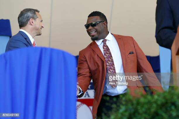 National Baseball Hall of Fame and Museum President Jeff Idelson greets Hall of Famer Ken Griffey Jr during the 2017 Hall of Fame Induction Ceremony...