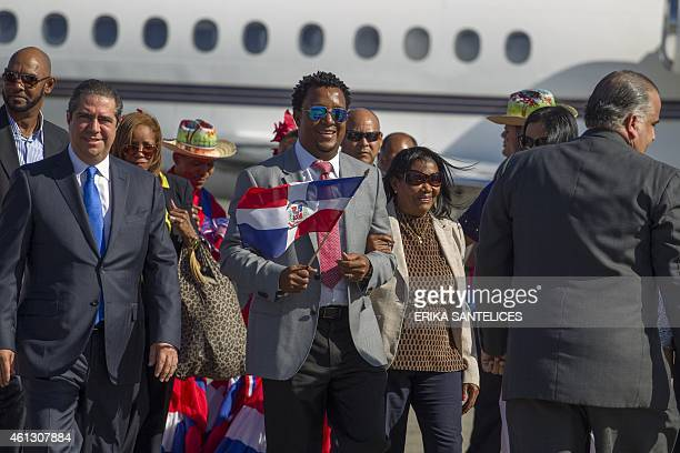National Baseball Hall of Fame inductee Pedro Martinez is greeted after deplaning at the Las Americas International Airport in Santo Domingo on...