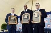 National Baseball Hall of Fame inductees Tom Glavine Frank Thomas and Greg Maddux pose with their Hall of Fame plaques after being inducted into the...