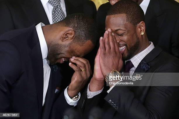 National Basketball Association 20122013 champion Miami Heat players LeBron James and Dwyane Wade share a laugh during an event in the East Room of...