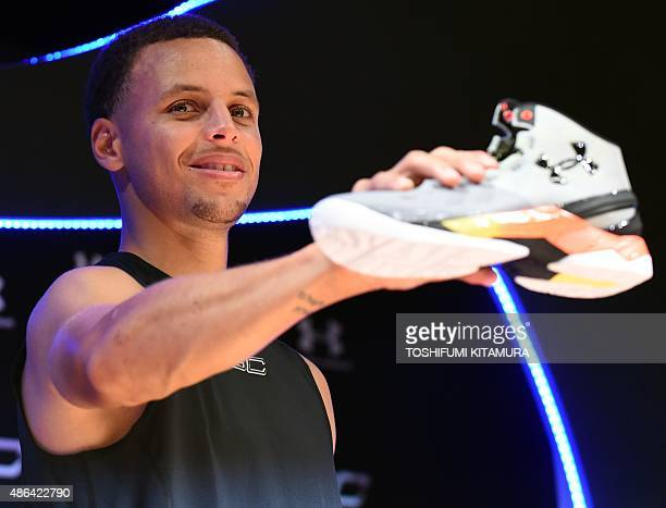 National Basketball Association Golden State Warriors 20142015 season MVP Stephen Curry poses with his 'UA Curry II' shoes during an event in Tokyo...