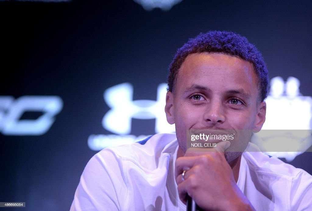 National Basketball Association (NBA) Golden State Warriors and 2014-2015 season Most Valuable Player (MVP) <a gi-track='captionPersonalityLinkClicked' href=/galleries/search?phrase=Stephen+Curry+-+Basketball+Player&family=editorial&specificpeople=5040623 ng-click='$event.stopPropagation()'>Stephen Curry</a> reacts during a press conference in Manila on September 5, 2015. Curry started his three-nation (Japan, China and Philippines) Under Armour Asia tour to promote the company's limited edition basketball shoes, 'UA Curry II'. AFP PHOTO / NOEL CELIS