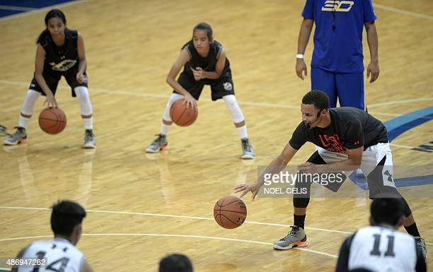 National Basketball Association Golden State Warriors and 20142015 season Most Valuable Player Stephen Curry dribbles the ball during a drill with...