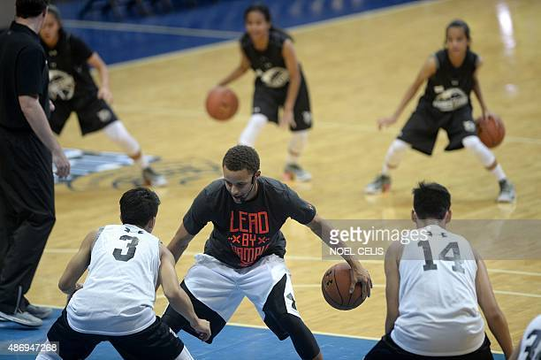 National Basketball Association Golden State Warriors and 20142015 season Most Valuable Player Stephen Curry takes part in a drill with young players...