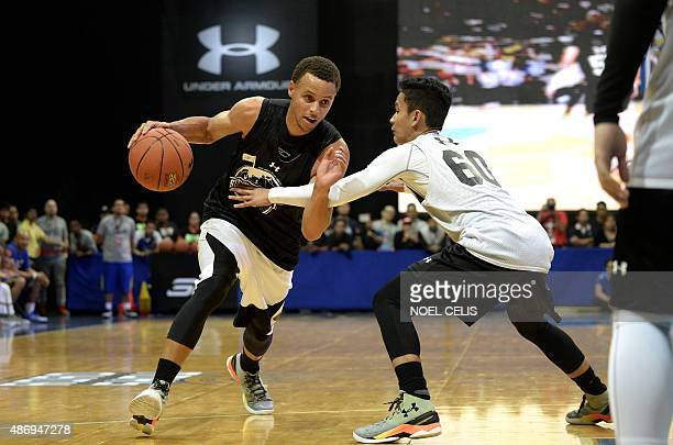National Basketball Association Golden State Warriors and 20142015 season Most Valuable Player Stephen Curry drives the ball during a drill with...