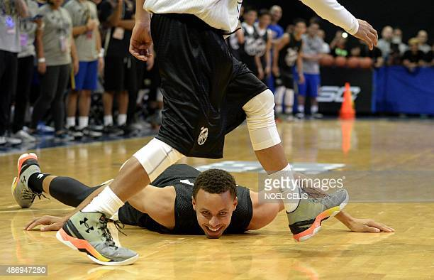 National Basketball Association Golden State Warriors and 20142015 season Most Valuable Player Stephen Curry lies on the floor after slipping during...