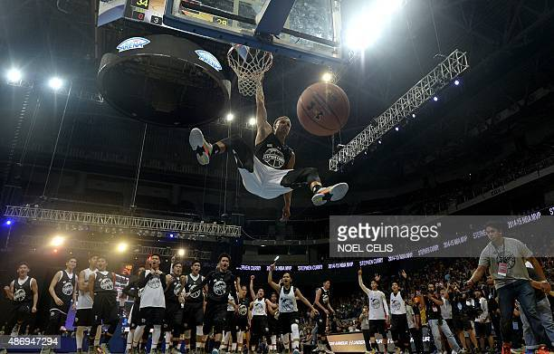 National Basketball Association Golden State Warriors and 20142015 season Most Valuable Player Stephen Curry dunks the ball during a drill with young...
