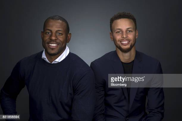 National Basketball Association's Golden State Warriors professional basketball players Andre Iguodala left and Stephen Curry sit for a photograph...