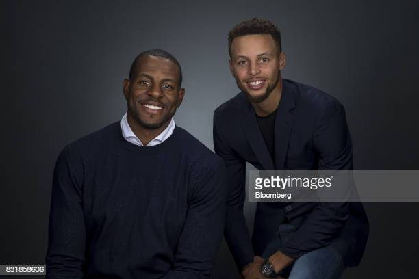 National Basketball Association's Golden State Warriors professional basketball players Andre Iguodala left and Stephen Curry smile for a photograph...