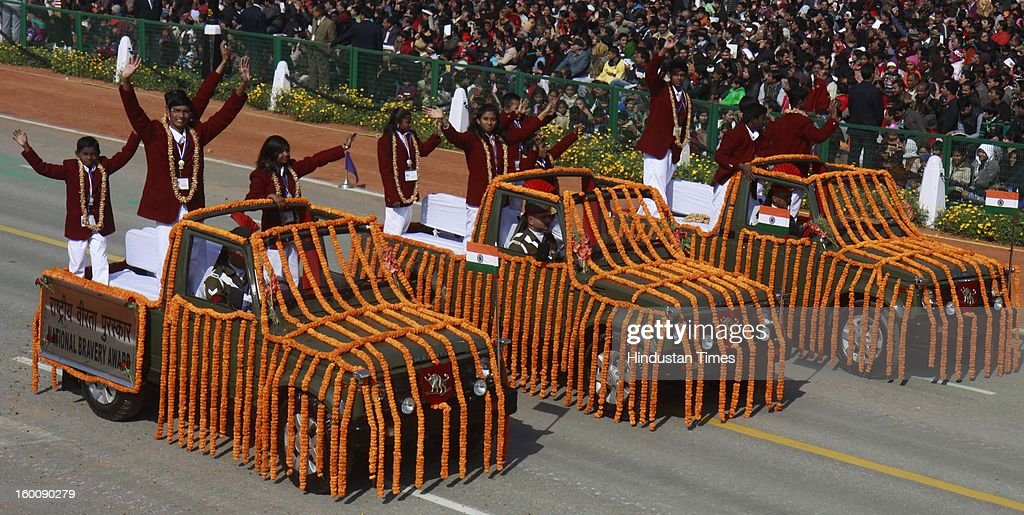 National Bravery awardees children's in open jeeps during the 64th Republic Day parade celebration at Raj path on January 26, 2013 in New Delhi, India. India marked its Republic Day with celebrations held under heavy security, especially in New Delhi where large areas were sealed off for an annual parade of military hardware.