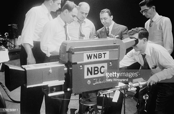 A National Broadcasting Company television crew showing a TV camera to British television executive Ronnie Waldman who is visitinig New York studios...