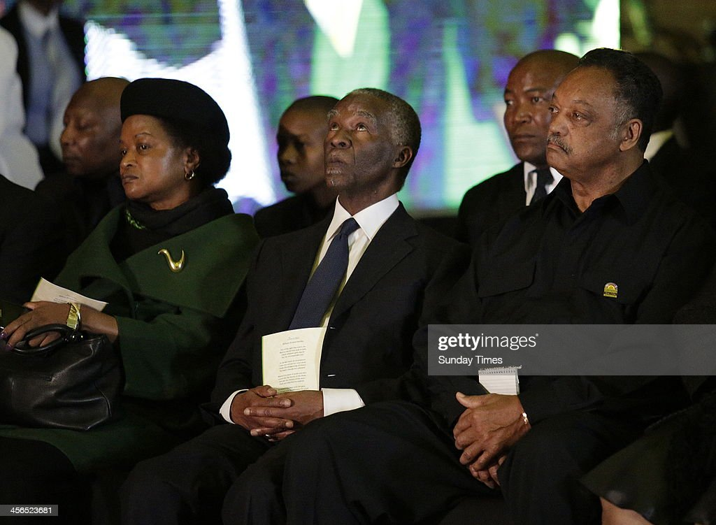 ANC National chairperson Baleka Mbete, former president Thabo Mbeki and Reverend Jesse Jackson at the official send-off for Nelson Mandela at the Waterkloof Air Base on December 14, 2013 in Pretoria, South Africa. World icon, Nelson Mandela passed away quietly on the evening of December 5, 2013 at his home in Houghton with family. Tata will be laid to rest at his homestead tomorrow.