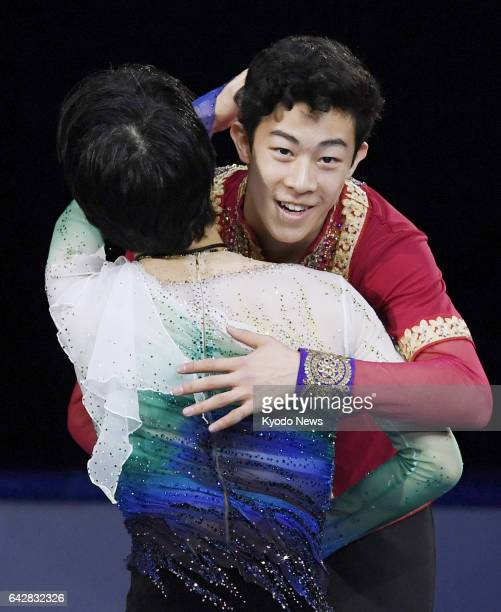 US national champion Nathan Chen is congratulated by Yuzuru Hanyu of Japan on the podium after winning the Four Continents championships in Gangneung...