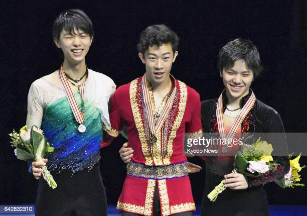 US national champion Nathan Chen Yuzuru Hanyu and Shoma Uno of Japan stand on the podium after winning the gold silver and bronze medals respectively...