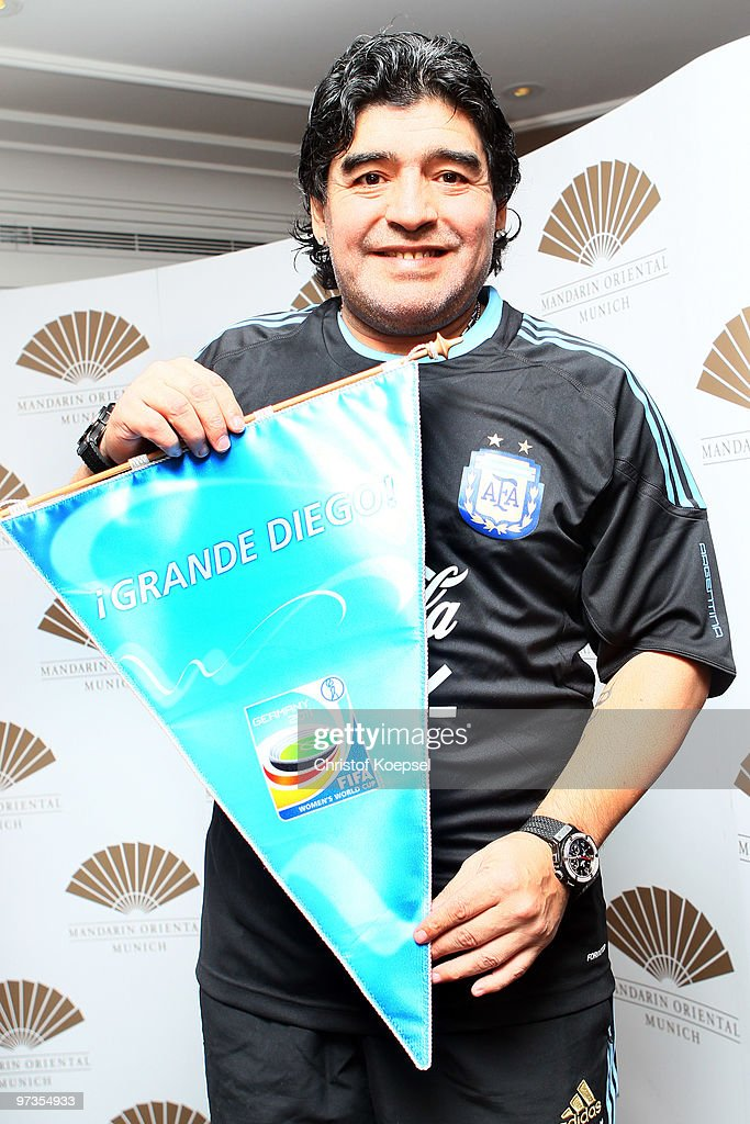 National coach Diego Maradona presents a pennant of the FIFA Womens World Cup after an Argentina national team press conference on March 1, 2010 in Munich, Germany.
