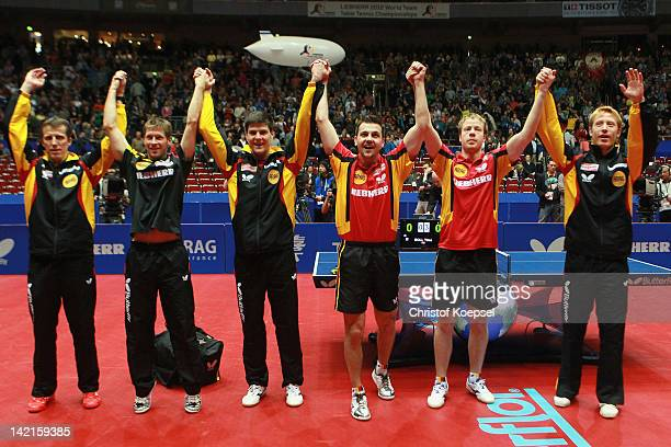 National coach Joerg Rosskopf Bastian Steger Dimitrij Ovtcharov Timo Boll Patrick Baum and Christian Suess of Germany celebrate the 30 victory...