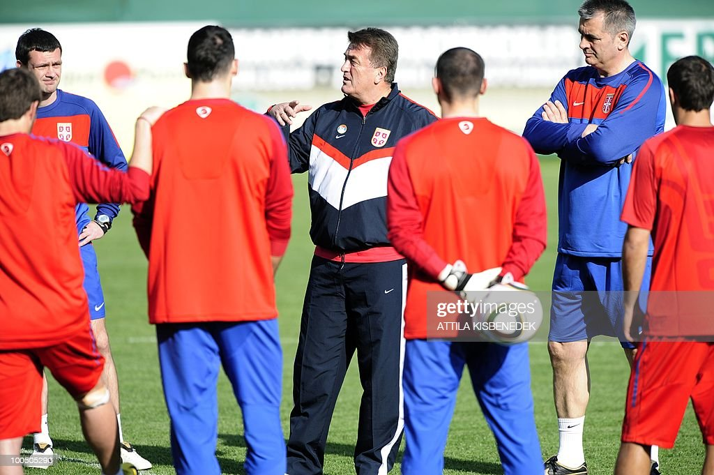 National coach of the Serbian team Radomir Antic (C) gives instructions to his team's players in the local stadium of Leogang, Austria on May 25, 2010 during the first training session of the Serbian team in their training camp to prepare for the 2010 World Cup in South Africa.Serbia's national team arrived in Austria for a two-week training camp ahead of the World Cup in South Africa next month.
