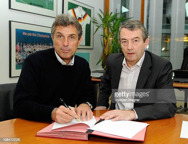 U21 national coach Rainer Adrion and general secretary Wolfgang Niersbach of German football Association sign a new contact at the headquarter of...
