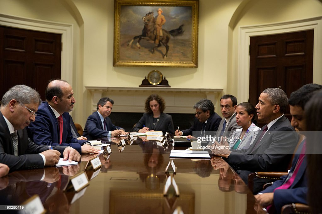 National Coalition for Syrian Revolutionary and Opposition Forces President Ahmad al-Jarba (2th L) meets US President Barack Obama (2th R) and U.S. National Security Adviser Susan Rice (3th R) in the Roosevelt Room of the White House, Washington, United States on May 13, 2014.