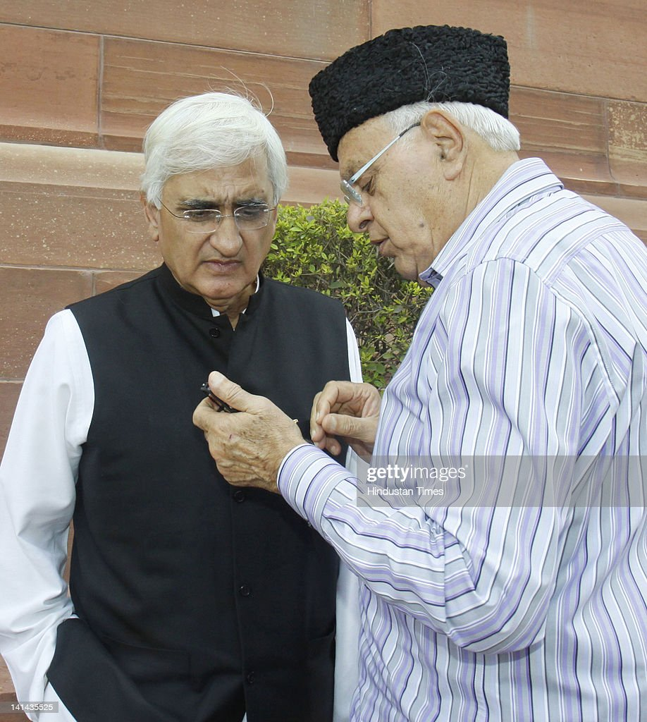 National Conference leader <a gi-track='captionPersonalityLinkClicked' href=/galleries/search?phrase=Farooq+Abdullah&family=editorial&specificpeople=2291127 ng-click='$event.stopPropagation()'>Farooq Abdullah</a> Taking with Union Law Minister Salman khurshid at Parliament House during the General Budget 2012-13 presentation on March 16, 2012 in New Delhi, India. Presenting his seventh budget Union Finance Minister Pranab Mukherjee gave some relief to individual tax relief as the income upto 2 lacs,, The Service Tax has been hiked from 10% to 12% .