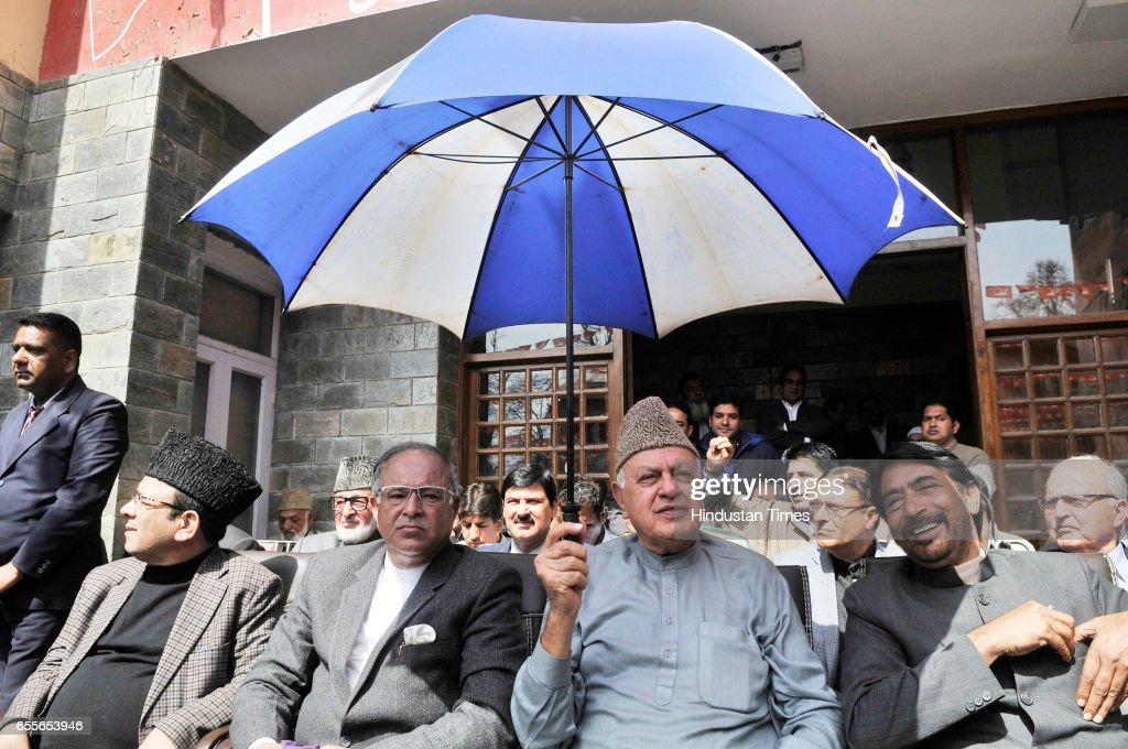 National Conference Patron and President Farooq Abdullah along with Ghulam Ahmad Mir and Congress leader Tariq Hamid Karra during an election rally after National Conference Patron and President Farooq Abdullah filling his nomination paper for parliamentary elections on March 20, 2017 in Srinagar, India.